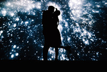 Dark Silhouette Of Kissing Couple On Background With Projection Of Starry Sky