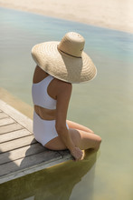 Young Woman In White Swimsuit ...