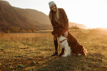 Woman Standing With Her Dog