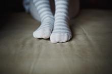 Legs Of A Little Girl In Knitt...