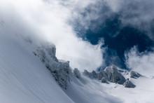 Jagged Mountain Peaks Swallowe...