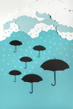 Umbrellas Under The Rain