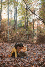 Kids Playing In The Woods