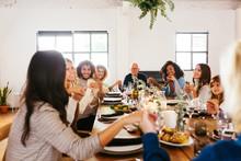 Diverse Family Praying At Table