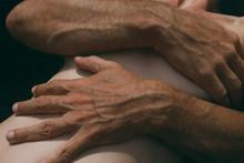 Male Hands Hugging Closeup