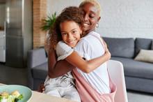 Little Girl Hugging Her Mom After Dinner