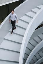Businessman Walking On Office ...