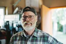 Portrait Of Older Blacksmith Looking At Camera