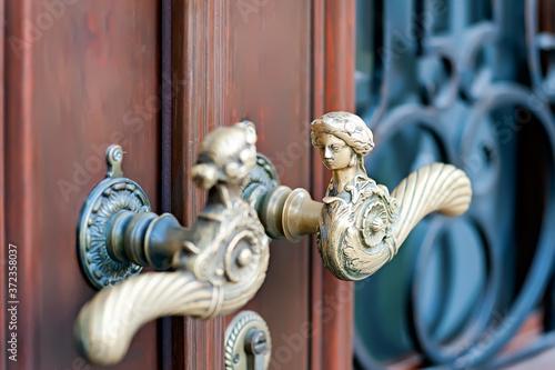 Ornate lever-style door handles of old building in Lviv Ukraine Canvas