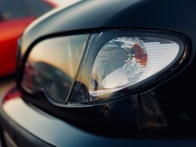 Car Headlight Close-up, Sunlight In Glass