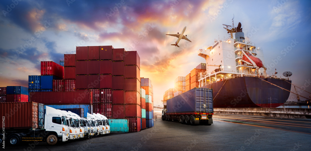 Fototapeta Container truck in ship port for business Logistics and transportation of Container Cargo ship and Cargo plane with working crane bridge in shipyard, logistic import export and transport industry