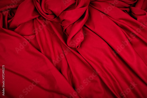Photo Dramatic closeup folds of dark red or wine red drapery (with copyspace for text)