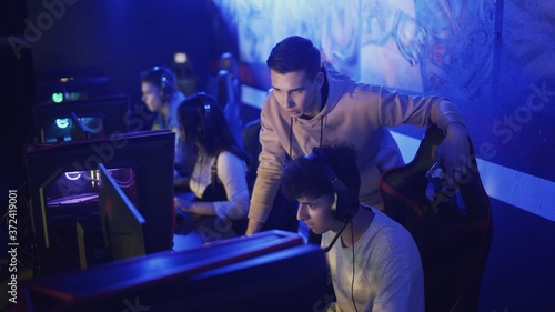 Fototapeta Pro Gamers trainer Explains Strategy to his apprentice