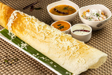 Cheese Masala Dosa With Different Types Of Chutney And Sambar. This Is A Closeup Shot Of One Of The Most Famous Indian Snack.