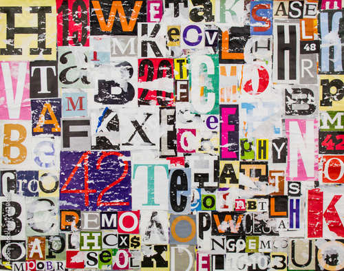 Colorful abstract collage from clippings with letters and numbers texture background Fotobehang
