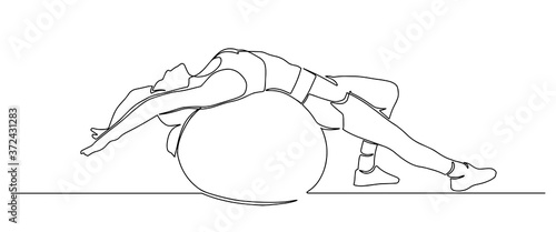 Fototapeta Beautiful girl in sports clothes sitting on a fitness ball one line. young girl doing exercises with fit ball continuous line drawing. woman doing pilates exercises with fit ball. Vector illustration. obraz