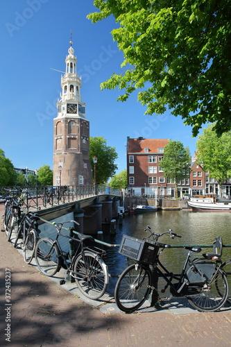 Fototapeta Montelbaanstoren Tower (built in 1516), located along Oudeshans canal in Amsterd