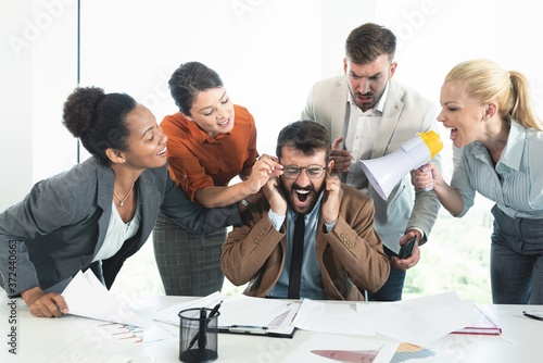 Colleagues criticizing boss for his wrong decision making Fototapeta