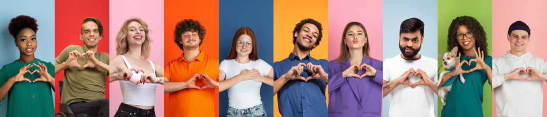 Collage of portraits of 10 young emotional people on multicolored background. Concept of human emotions, facial expression, sales, love, charity. Smiling, gesturing, heart sign with hands, kind.