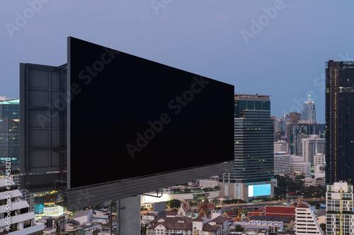 Leinwand Poster Blank black road billboard with Bangkok cityscape background at sunset