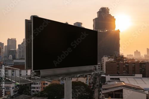 Obraz na plátně Blank black road billboard with Bangkok cityscape background at sunset