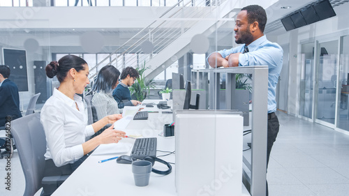 Canvastavla In Modern Office: Handsome Black Manager Flirts with Beautiful Female Business Specialists Working on Her Desk