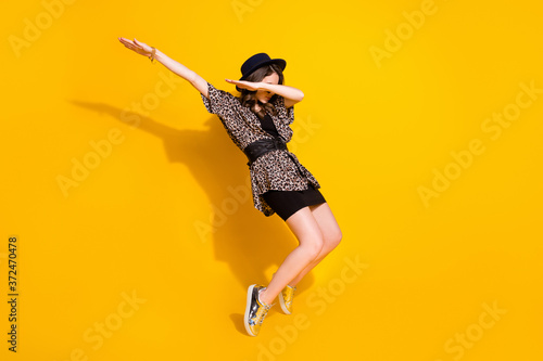 Full length turned photo of cool crazy dabber girl dance close cover hands face Fototapete
