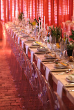 Table Setting In A Room With R...