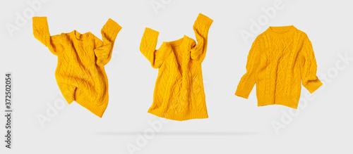 Yellow orange flying women's autumn knitted sweater on light gray background Billede på lærred