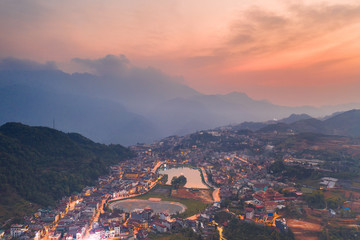 Aerial view of panorama landscape at the hill town in Sapa city, Vietnam with the sunny light and sunset, mountain view in the clouds