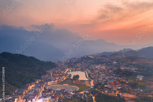 Obraz Aerial view of panorama landscape at the hill town in Sapa city, Vietnam with the sunny light and sunset, mountain view in the clouds - fototapety do salonu