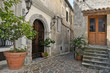 A narrow street among the old houses of Orsomarso, a rural village in the Calabria region.