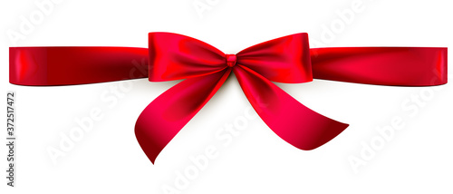 Fotografiet Red satin ribbon bow. Horizontal wrap