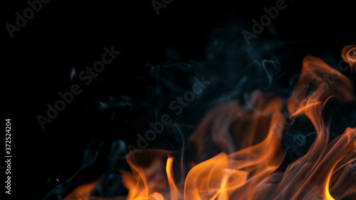 Tablou Canvas fire flames with sparks on a black background, close-up