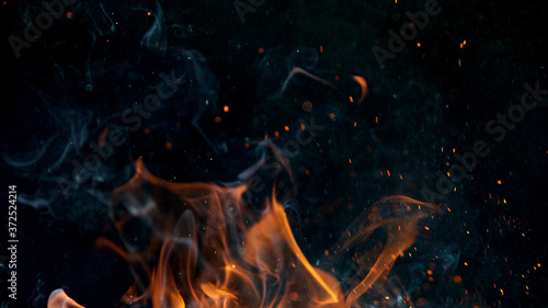 Photo fire flames with sparks on a black background, close-up