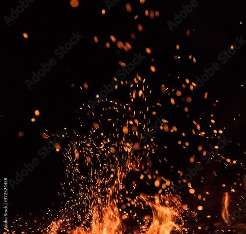 Obraz fire flames with sparks on a black background, close-up - fototapety do salonu