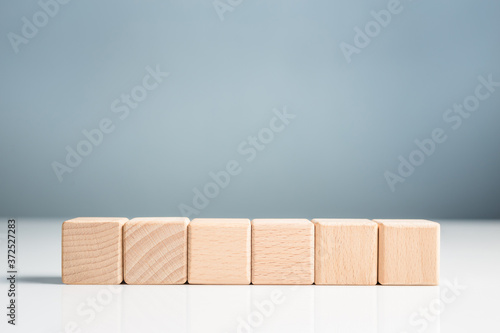 Fototapeta Wooden Cubes in a Row, Element for Insert Text or Icon with Copy Space on Wall B