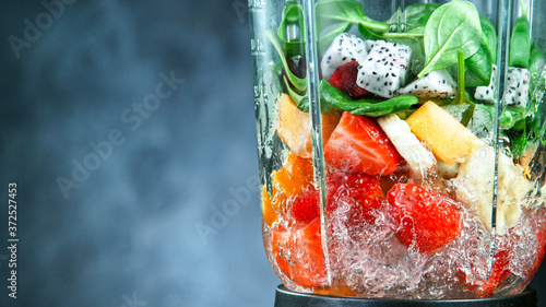 Obraz na plátně Fresh fruit and vegetables smoothie blended in blender, back view