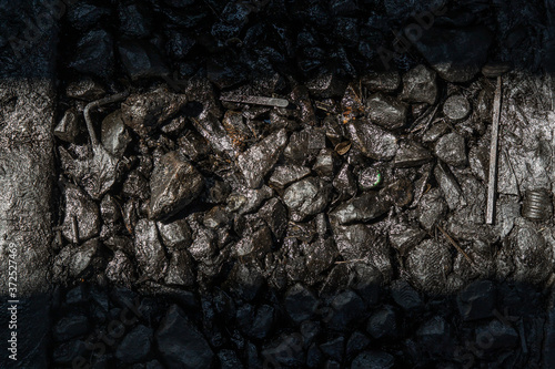 Ballast stone gravel soaked with engine oil in the railroad tracks, Stone background Wallpaper Mural
