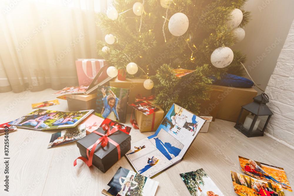 Fototapeta family photo album near the Christmas tree