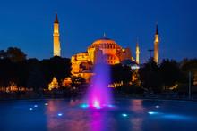 Turkey, Istanbul, Fountain InSultan Ahmet Park At Night WithHagia Sophia In Background