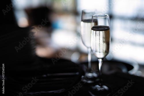 selective focus, two glasses of cold white wine in dark room