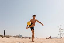 Shirtless Male Athlete Playing...