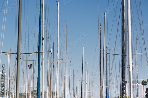 mast line of upper part of sailboat masts, repeating random patterns, speaks of boats and boating, the good life, adventure, lifestyle, background, marina, fun weekends, Billede på lærred