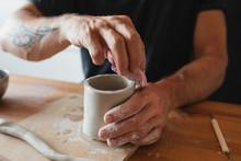 Unrecognizable Ceramist Using ...