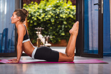 Fit Woman Stretching Back On Y...