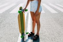 Crop Girl Holding A Skateboard...