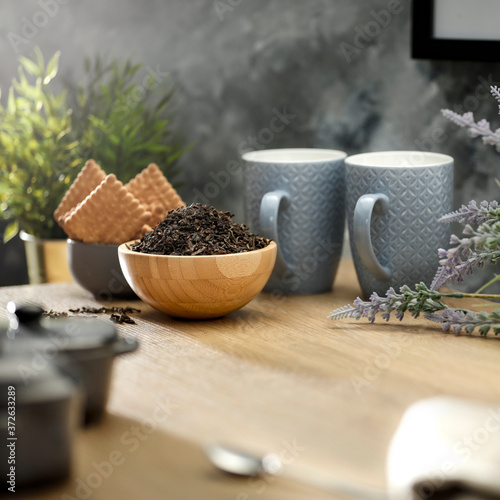 Photographie Tea on a wooden table in a sunny afternoon room
