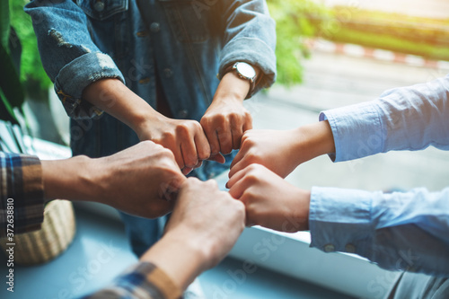 Papel de parede Group of business team work join their hands together with power and successful
