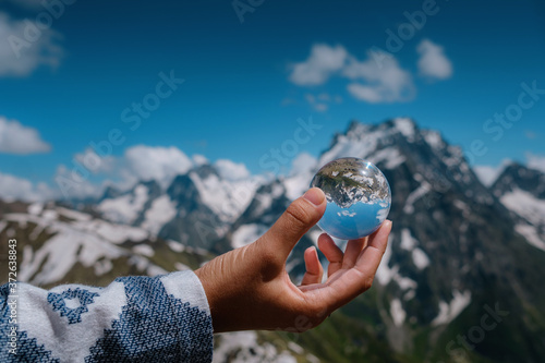 Obraz na plátně beautiful spherical glass ball with majestic Caucasian mountains